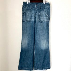 DIESEL Distressed wide leg/flare button fly jeans